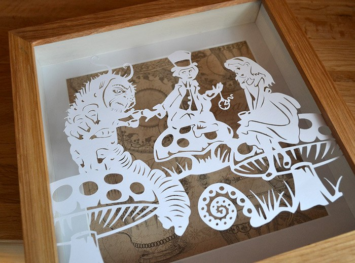 hand cut Alice papercut