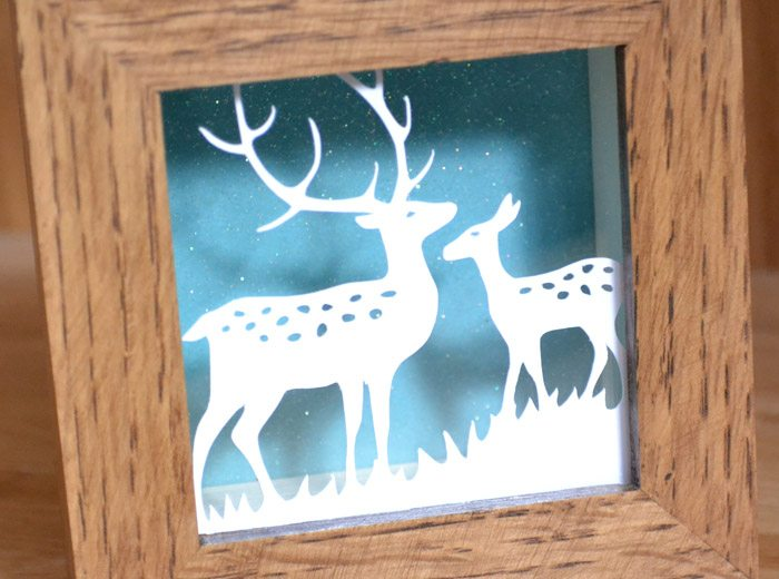 deep oak framed paper cut
